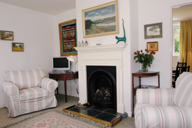 Lounge at Drift Cottage, Self catering accommodation in Dale Pembrokeshire near West Dale and Dale Beaches. Ideal for windsurfing, sailing, diving, birdwatching, walking.